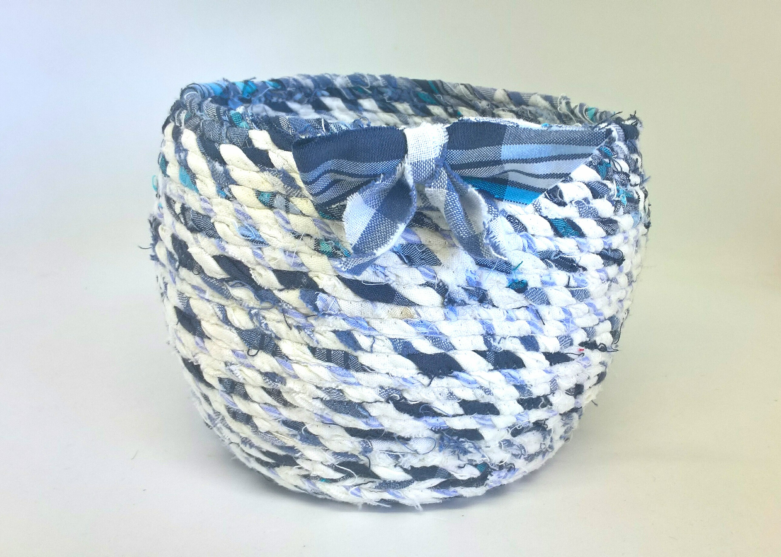 small blue and white fabric basket